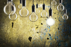 Idea and leadership concept -  bulbs on the grunge background Royalty Free Stock Photos