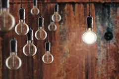 Idea and leadership concept -  bulbs on the grunge background Royalty Free Stock Photography