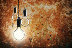 Idea and leadership concept -  bulbs on the grunge background Royalty Free Stock Photo