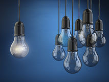Idea or leadership concept. Group of light bulbs on the blue bac Stock Images