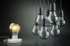 Idea or leadership concept. Group of lightbulbs on the black bac Stock Photography