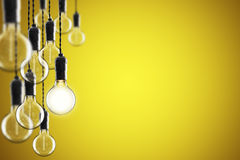 Idea and leadership concept Vintage  bulbs on color background, Stock Photography
