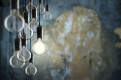 Idea and leadership concept Vintage  bulbs on wall background Royalty Free Stock Photography
