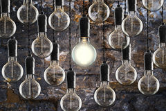 Idea and leadership concept Vintage  bulbs on wall background Stock Photos