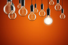 Idea and leadership concept Vintage incandescent Edison bulbs on Royalty Free Stock Photos