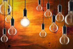 Idea and leadership concept Vintage incandescent Edison bulbs on Stock Photography