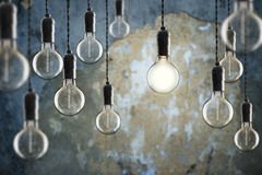 Idea and leadership concept Vintage incandescent Edison bulbs on Royalty Free Stock Image