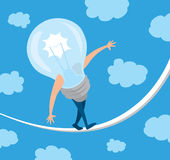 Idea light bulb in balance walking on a string Stock Images
