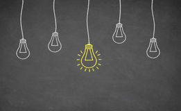 Idea Light Bulb on Blackboard Stock Photo