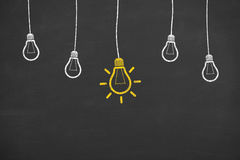 Idea Light Bulb on Blackboard Royalty Free Stock Image