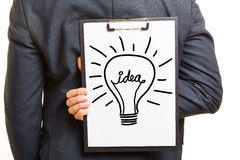 Idea with light bulb on clipboard Stock Image