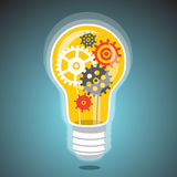 Idea light bulb with cogs Stock Photography