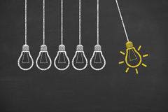 Idea Light Bulb Conceptual Work on Blackboard. On working business concept Royalty Free Stock Photos