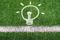 Idea light bulb hand drawing on soccer field grass Royalty Free Stock Image