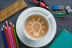 Idea light bulb icon inside a coffee cup Royalty Free Stock Images
