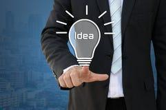 Idea light bulb idea of new innovation. Businessman pointing idea light bulb idea of new innovation, business concept royalty free stock image