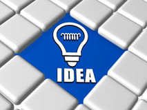 Idea and light bulb sign in boxes. Idea and light bulb sign - 3d white text and symbol over blue between grey boxes keyboard, business concept Stock Photography