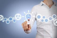 Idea Light Bulb Touching on Visual Screen. On working business concept Royalty Free Stock Images