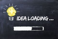 Idea loading bar concept with lighting bulb on chalkboard Royalty Free Stock Photos