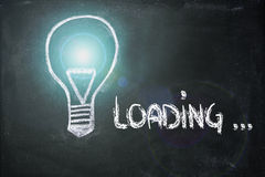 Idea loading, lightbulb on blackboard Royalty Free Stock Photos