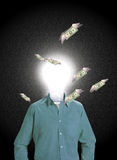 IDEA MAN. Attracts wealth A figure with a glowing bulb for a head stands while winged money flies around him Stock Images