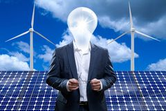 Idea man in front of a solar panel. Stock Photography