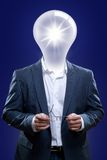 Idea man with a light bulb head. Stock Photos