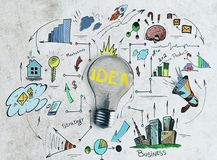 Idea and management concept. Lamp with business sketch on abstract concrete wall background. Idea and management concept Stock Photography