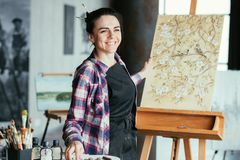 Idea memories delight woman artist painting art. Great idea. Happy memories and delight. Smiling woman artist with painting on easel at virtual object. Art royalty free stock photo
