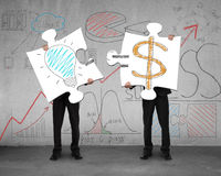 Idea is money concept on puzzles with men holding Royalty Free Stock Photo