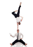 Idea of multitasking - businessmen-gymnasts Stock Image