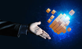 Idea of new technologies and integration presented by cube figure Stock Photo