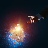 Idea of new technologies and integration presented by cube figure. Close of businessman hand holding cube figure as symbol of innovation, mixed media Royalty Free Stock Image
