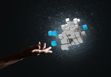 Idea of new technologies and integration presented by cube figure. Close of man hand holding cube figure as symbol of innovation. 3D rendering Royalty Free Stock Images