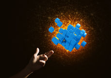 Idea of new technologies and integration presented by cube figure. Close of man hand holding cube figure as symbol of innovation. Mixed media Royalty Free Stock Photography