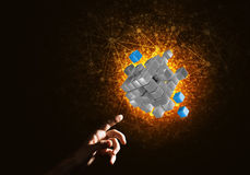 Idea of new technologies and integration presented by cube figure. Close of man hand holding cube figure as symbol of innovation. Mixed media Royalty Free Stock Photos