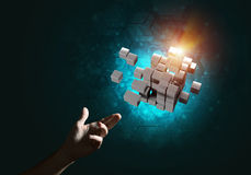 Idea of new technologies and integration presented by cube figure. Close of man hand holding cube figure as symbol of innovation. Mixed media Royalty Free Stock Images