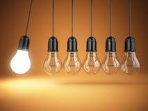 Idea o creativity concept. Light bulbs and perpetual motion. Royalty Free Stock Photo