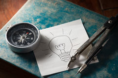 Idea paper with compass on book. Stock Image