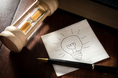 Idea paper with pen and hourglass. Royalty Free Stock Photography