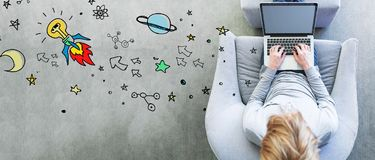 Idea Rocket with man using a laptop Stock Photography