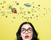 Idea rocket with young woman stock photography