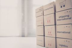 Idea of shopping online and service / e-commerce concept. Stack boxes on laptop for Customer can buy from electronic internet royalty free stock images