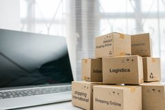 Idea of shopping online and service / e-commerce concept. Stack boxes on laptop for Customer can buy from electronic internet stock photo