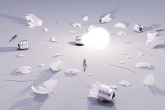 Idea solution concept with glowing lightbulb and broken lightbul Stock Photography