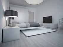 Idea of spacious modern bedroom with grey walls Stock Photos