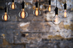Idea and teamwork concept Vintage  bulbs on wall background Royalty Free Stock Image