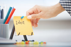 Idea text on adhesive note Stock Photo