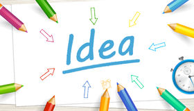 Idea text, sheets of paper, colored highly detailed pencils Royalty Free Stock Photo