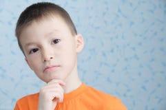 Idea thinking adorable boy portrait closeup, solving problem concept stock photography